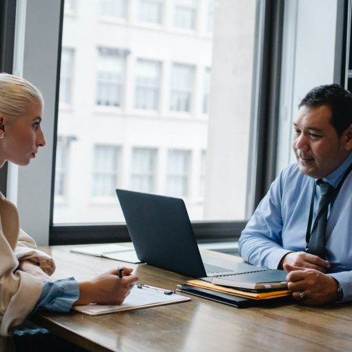 focused ethnic male boss interviewing applicant in office